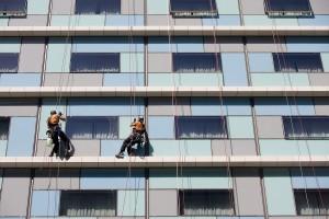 bigstock-Workers-washing-the-windows-fa-30667373
