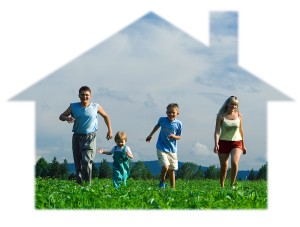family mother father and two child run in house on field under b