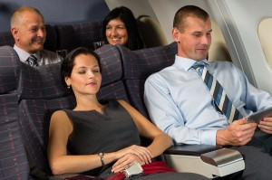 Airplane passengers relax during flight cabin sleep businesspeop